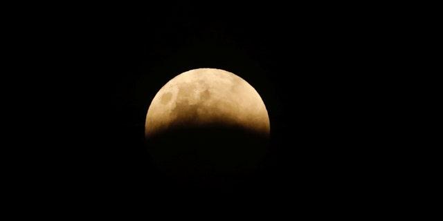 A full moon is seen during a lunar eclipse in Jakarta, Indonesia Jan. 31, 2018. (REUTERS/Darren Whiteside)
