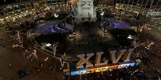 Feb. 1, 2012: Fans have their photos taken in front of the NFL Super Bowl XLVI sign on Monument Circle in Indianapolis.