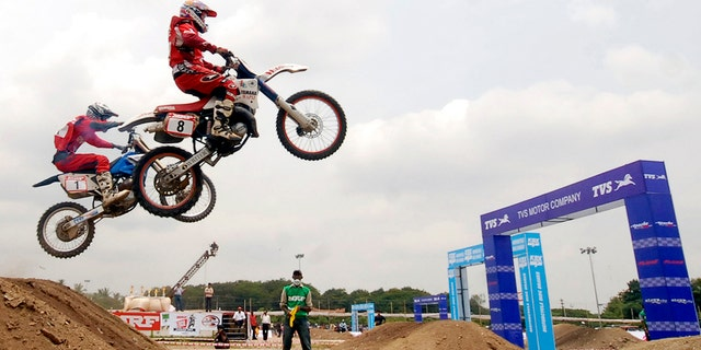 Riders participate in the Supercross Motor Bike Championship 2008 in the southern Indian city of Hyderabad July 20, 2008. More than 100 riders throughout the country took part in the national-level championship on Sunday. REUTERS/Krishnendu Halder (INDIA) - RTR20DB8