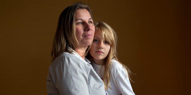 Nov. 14, 2014: Peggy Young, of Lorton, Va., with her daughter Triniti, 7, in Washington.