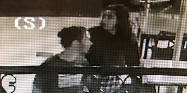 Surveillance footage from outside the Birchwood Inn, owned by Chuck Prather, shows two people posting the fliers.
