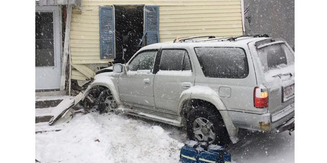 SUV crashed into house during snowstorm.