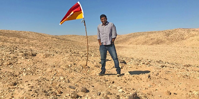 """Suyash Dixit planted a flag to establish the """"Kingdom of Dixit"""" in barren Bir Tawil."""