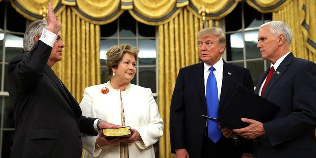 Rex Tillerson being sworn in as Secretary of State in front of President Donald Trump and Vice President Mike Pence.