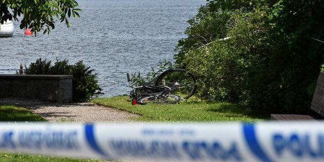 In this Tuesday, July 31, 2018 photo, a discarded bicycle near the scene of a robbery at the Strangnas Cathedral, in Strangnas, Sweden.