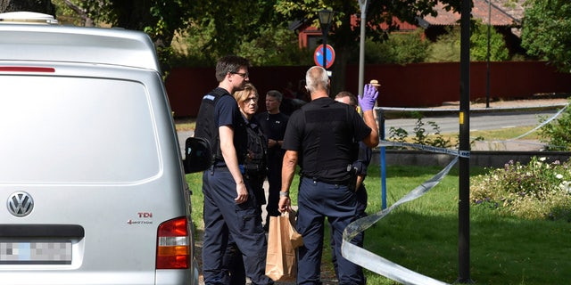 In this Tuesday, July 31, 2018 photo, police near the scene of a robbery at the Strangnas Cathedral, in Strangnas, Sweden.
