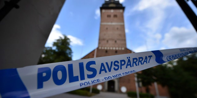 In this Tuesday, July 31, 2018 photo, a police cordon near the scene of a robbery at the Strangnas Cathedral, in Strangnas, Sweden.