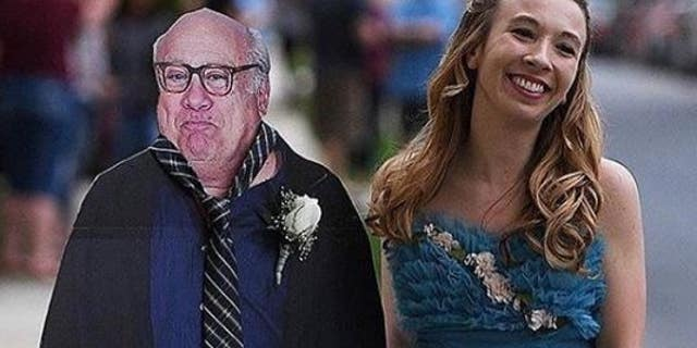 Allison Closs poses with a cardboard cutout of Danny DeVito that she took to her school's prom.