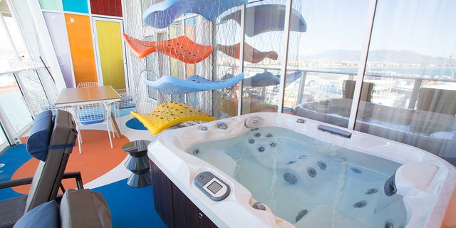 The whirlpool on the balcony offers views of the ship.