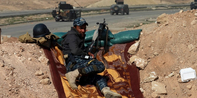 Iraqi special forces advance towards western Mosul, Iraq.