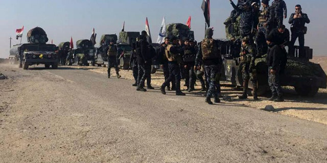 Iraqi federal police forces advance towards the western side of Mosul, Iraq.