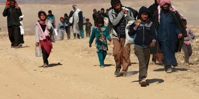 Displaced Iraqis flee their homes due to fighting between Iraqi special forces and Islamic State militants.