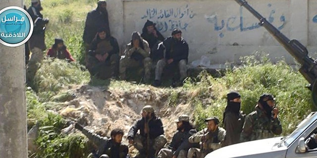 This image posted on the Twitter page of Syria's Al Qaeda-linked Nusra Front on Saturday, April 25, 2015, which is consistent with AP reporting, shows Nusra Front fighters in the town of Jisr al-Shughour, Idlib province, Syria.
