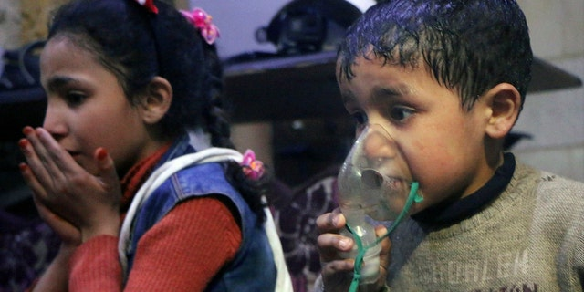 Children are seen in Douma, Syria, following last week's chemical weapons attack.