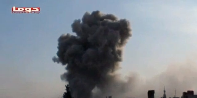 Nov. 9, 2012: In this image taken from video obtained from Shaam News Network, smoke is shown rising from a residential area of the city during bombing from military warplanes, in Douma, Syria.