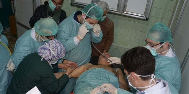 In this photo released by the Syrian official news agency SANA, a Syrian victim who suffered an alleged chemical attack receives treatment at a hospital in Aleppo. (AP Photo/SANA)