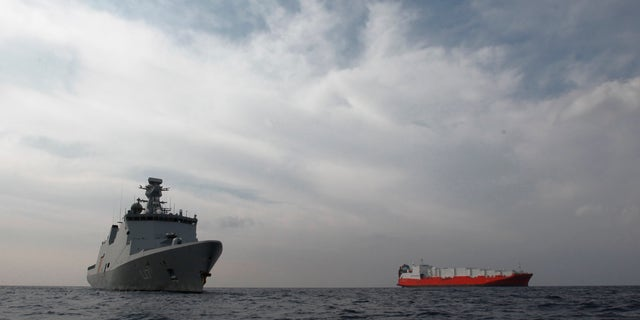 Jan. 3, 2014: A Danish warship, Esbern Snare  left, and a cargo and the Norwegian cargo ship are seen at the sea between Cyprus and Syria; they will wait for orders on when they can head to the Syrian port of Latakia to pick up more than 1,000 tons of chemical agents.