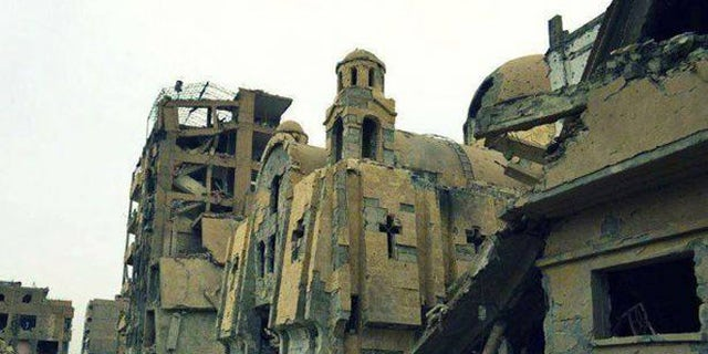 The Rev. Ibrahim Nseir's Presbyterian church in Aleppo was destroyed in a bombing, forcing the congregation to meet in a dark apartment while they rebuilt.