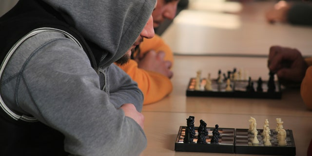 "Locals in the ""anti-extremist"" program engage in a wide array of entertainment activities, including chess"