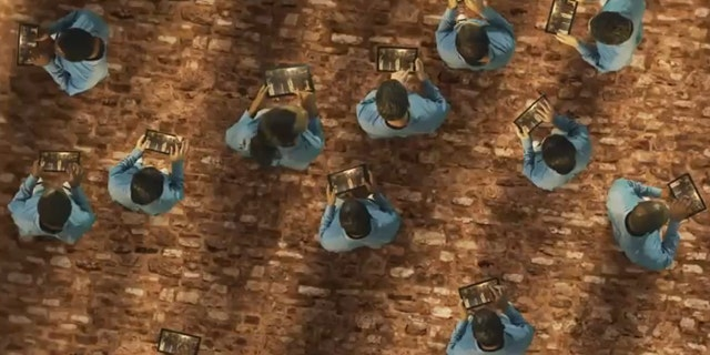 TabCo's new ad depicts current tablet buyers as lemmings falling off a cliff.