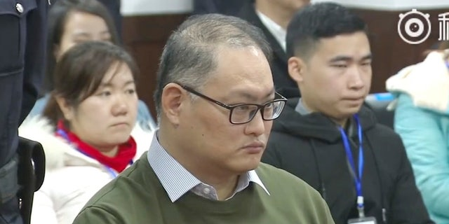 In this image taken from video released on Nov. 28, 2017, by the Intermediate People's Court of Yueyang, Taiwanese activist Lee Ming-che sits during a court session at the Intermediate People's Court of Yueyang in Yueyang in central China's Hunan Province, Tuesday, Nov. 28, 2017.