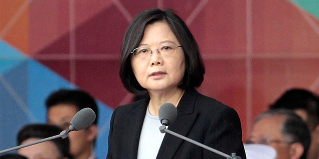 FILE - In this Oct. 10, 2016, file photo, Taiwan's President Tsai Ing-wen delivers a speech during National Day celebrations in front of the Presidential Building in Taipei, Taiwan.