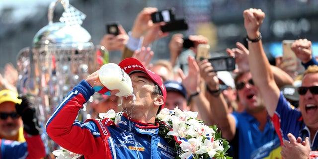 2017 champion Takuma Sato drinking milk.