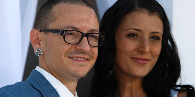 Chester Bennington of Linkin Park and wife Talinda arrive at the 2012 Billboard Music Awards in Las Vegas, Nevada, May 20, 2012.