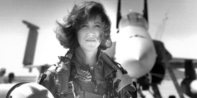 In this image provided by the U.S. Navy, Lt. Tammie Jo Shults, one of the first women to fly Navy tactical aircraft, poses in front of an F/A-18A with Tactical Electronics Warfare Squadron (VAQ) 34 in 1992.