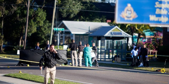 Law enforcement agents investigate a fatal shooting in the Seminole Heights neighborhood in Tampa, Fla., Tuesday, Nov. 14, 2017.