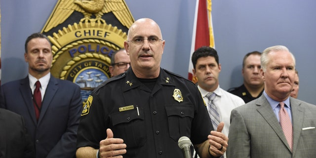 Tampa Police Chief Brian Dugan, center, along with Mayor Bob Buckhorn, right, announce that they intend to charge Howell Emanuel Donaldson, 24, with four counts of first degree murder in connection with the Seminole Heights homicides, Tuesday, Nov. 28, 2017, in Tampa, Fla.