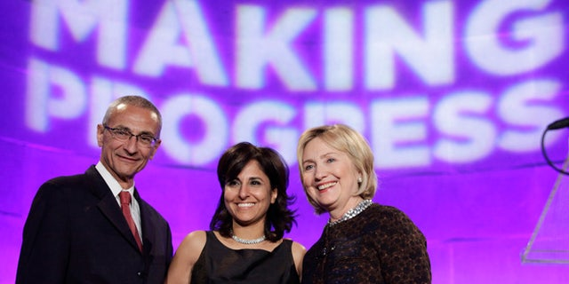 John Podesta, left, Neera Tanden and Hillary Clinton at a policy forum in 2013.