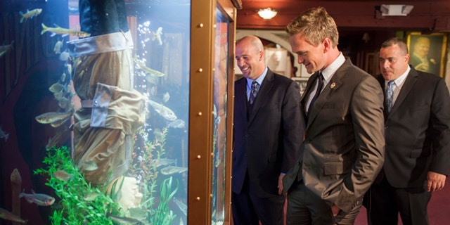July 20, 2012. Los Angeles, California. Animal Planet's 'Tanked', co-stars,  Wayde King and Brett Raymer install a magician themed aquarium at The Magic Castle in Los Angeles. Actor Neil Patrick Harris who is president of The Academy of Magical Arts was present, overseeing the installation.  Pictured (L-R) Brett Raymer, Neil Patrick Harris and Wayde King.Photo © 2012 Discovery Communications