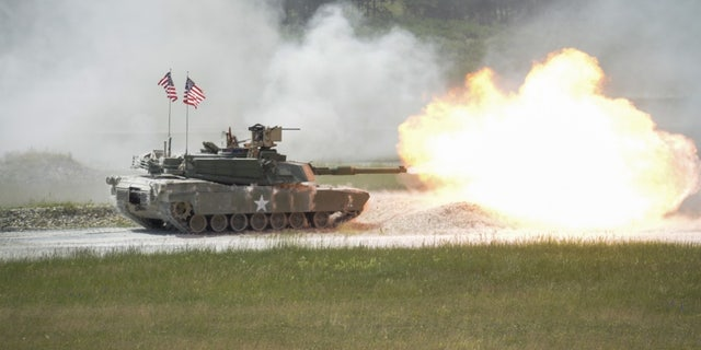 File photo - A United States M1A2 SEP fires its main gun during the shoot-off of Strong Europe Tank Challenge at Grafenwoehr Training Area, June 3 - 8, 2018.