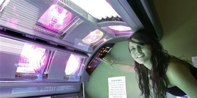 Rosie McDavid, 17, who has been using tanning beds since she was 14, prepares a tanning bed for a session, Wednesday, March 25, 2009, in Tallahassee, Fla.  The Florida Legislature is considering a bill that would restrict tanning bed use by minors. (AP Photo/Phil Coale)