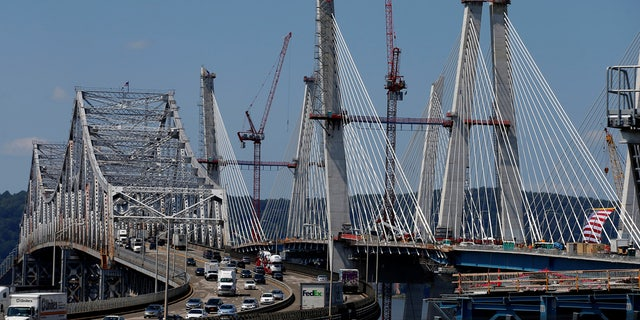The new Governor Mario M. Cuomo Bridge (R) that is to replace the Tappan Zee Bridge (L) over the Hudson River is seen in Tarrytown, New York, August 24, 2017.