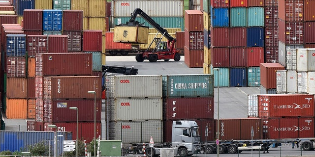 Containers are stored for export at a harbor in Duisburg, Germany, Monday, April 30, 2018