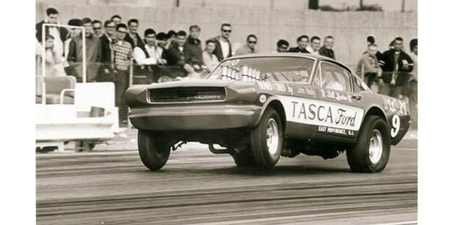 """The Tasca Mystery 9 altered-wheelbase Mustang takes a bite of California's Irwindale Raceway at the 1966 AHRA Winternationals with more than 600-hp worth of Hillborn-injected Ford 427 SOHC """"cammer"""" V-8 authority."""