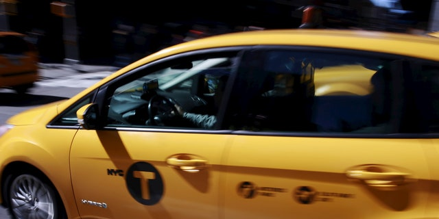 A tech company released a new app Thursday that will do for yellow taxis what Uber does for black cars — connecting riders with drivers and setting a price ahead of time. (REUTERS/Lucas Jackson)