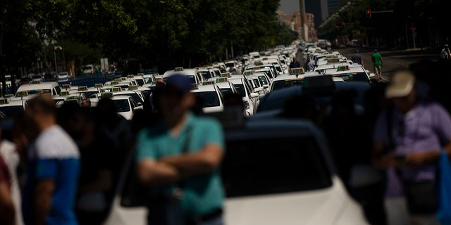 Taxi drivers in Madrid parked their cars and commiserated with their colleagues in the streets.