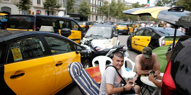 Drivers of Barcelona's signature black and yellow cars have been bringing sections of the city to a standstill last Wednesday.