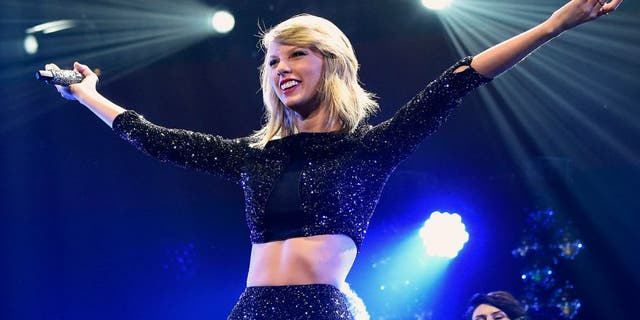 LOS ANGELES, CA - DECEMBER 05: Singer Taylor Swift performs onstage during KIIS FM's Jingle Ball 2014 powered by LINE at Staples Center on December 5, 2014 in Los Angeles, California. (Photo by Kevin Mazur/WireImage)