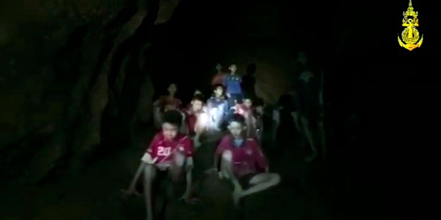 In this grab taken from video provided by Thai Navy SEAL, rescuers get their first view of the boys and their soccer coach.