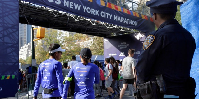 A New York City police office stands near the finish line of the New York City Marathon, in New York's Central Park, Friday, Nov. 3, 2017.