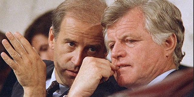 """Kennedy, shown here conferring with future Vice President Joe Biden, painted a frightening picture of """"Judge Bork's America."""""""