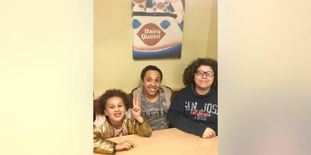 Elijah (middle) and his two sisters.