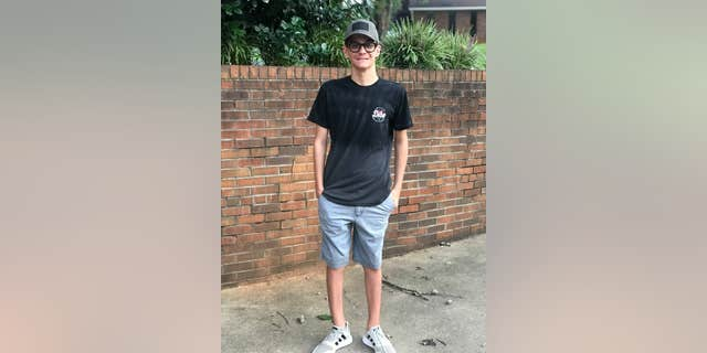 Andrew Kirby poses for a picture as he begins his junior year at Boiling Springs High School in South Carolina.