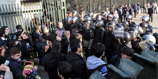 Dec. 30, 2017: In this photo taken by an individual not employed by the Associated Press and obtained by the AP outside Iran, anti-riot Iranian police prevent university students from joining other protesters in Tehran, Iran.
