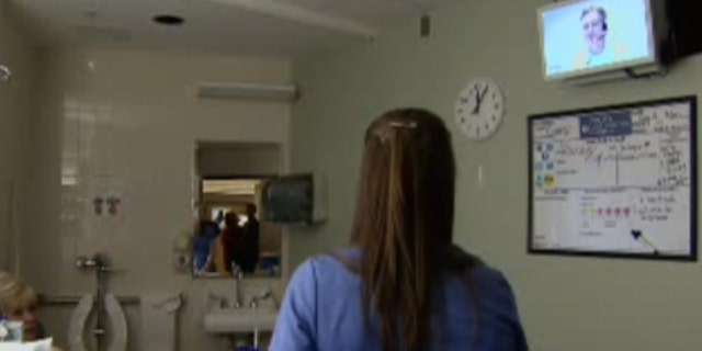 The Emory anesthesiologist spoke with Fox News using his hospital system's video conferencing capabilities from Perth, Australia, where the time difference is 12 hours. As he consulted with patients and on-site staff beginning an overnight shift back in the states, morning sunlight could be seen streaming into Sharifpour's work station at Royal Perth Hospital.