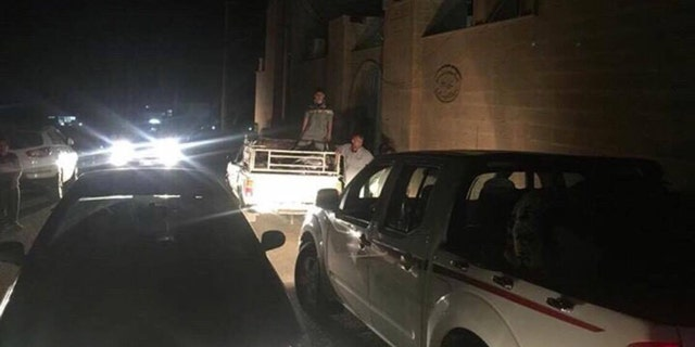 Villagers rushed to leave Teleskof on Tuesday evening after an Iraqi emissary told them to evacuate before sunrise in anticipation of further gunfire.